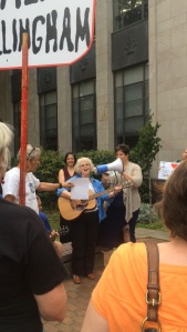 Linda Allen performing her song in support of earned leave.
